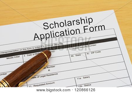 Applying for a Scholarship Scholarship Application Form with Pen on a desk