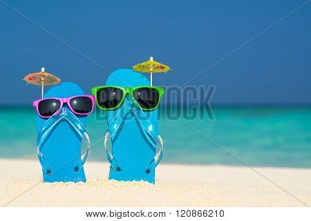 Flip-flops And Sunglasses By The Sea