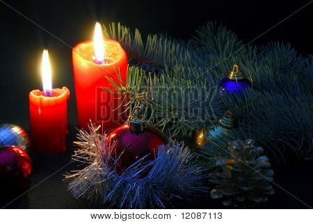 Christmas candles with some decoration in low light