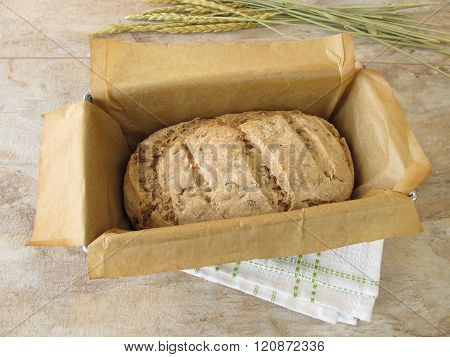 Green spelt bread in baking form