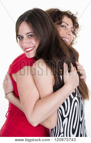 Two  Affectionate Young Woman Hugging Each Other In Close Embrace