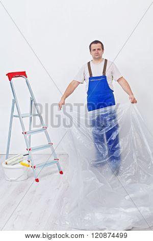 Worker Preparing The Room To Repaint
