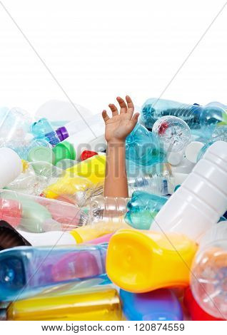 Child Hand Sticking Out From Plastic Bottles Garbage