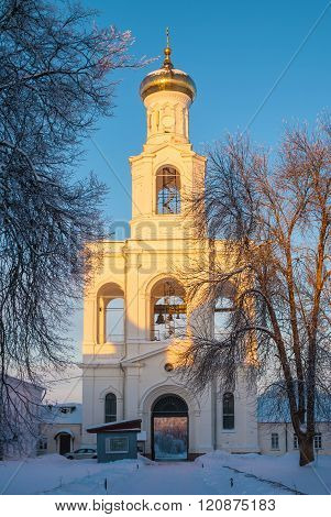 Convent belfry in winter scene at sunset