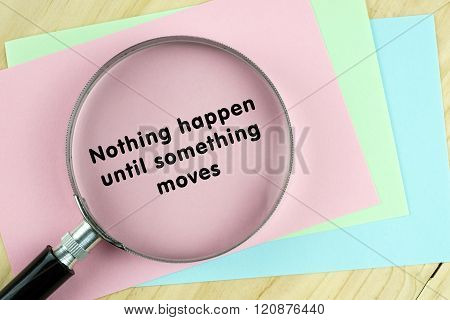 Magnifying glass on papers with inspirational words