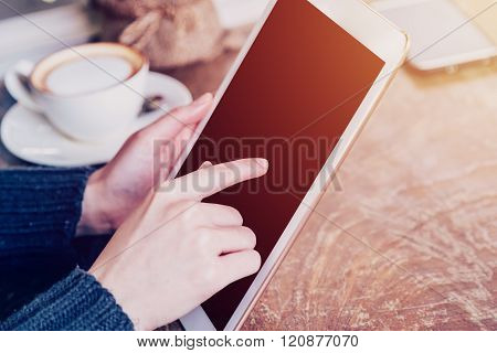 Hand Woman Playing Tablet In Coffee Shop With Vintage Tone.
