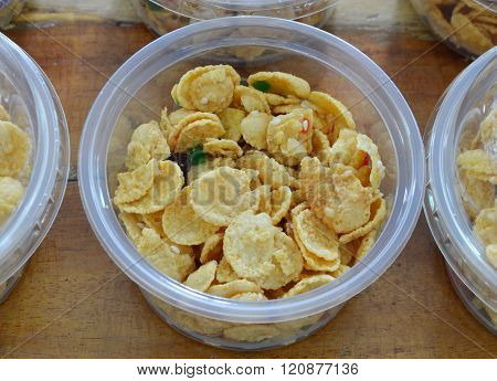 cornflakes in circle plastic cup on table
