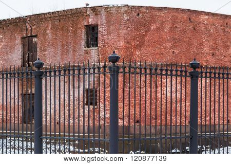Wrought iron fence and brick facade