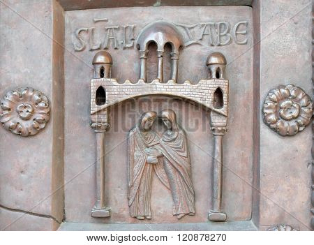 PISA, ITALY - JUNE 06, 2015: Visitation of the Virgin Mary on the San Ranieri gate of the Cathedral St. Mary of the Assumption in Pisa, Italy on June 06, 2015