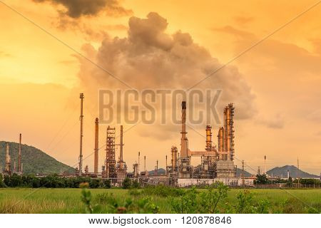 Oil Refinery Plant On Golden Sunshine Background.
