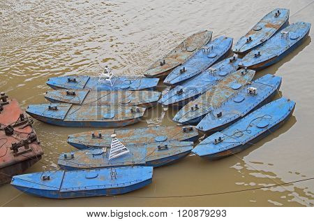 few small boats on river Yangtze in Chongqing