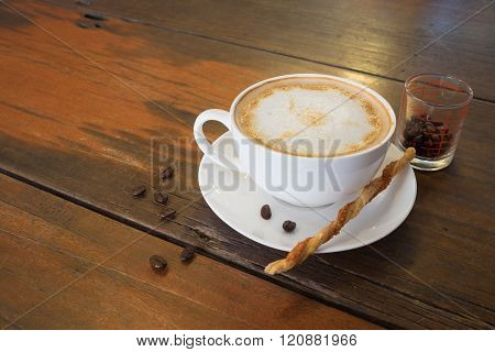 Hot Coffee And Coffee Bean On Wooden Table And Twisted Sweet Stick Biscuit/hot Coffee And Coffee Bea