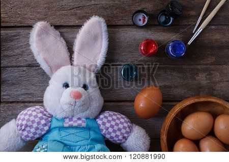 Easter Day With Eggs,color And Rabbit On Wood Background