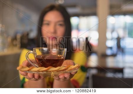 Woman In Colorful Dress Is Drinking And Sipping Hot Tea In Coffee Shop, Blurry/ Hot Tea And Blurry W