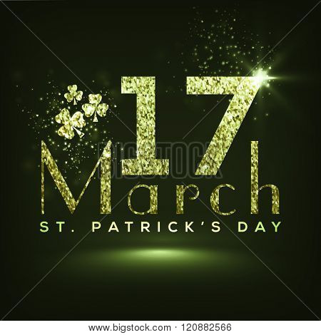 Creative text 17 March made by green glitter on shiny background for Happy St. Patrick's Day celebration.