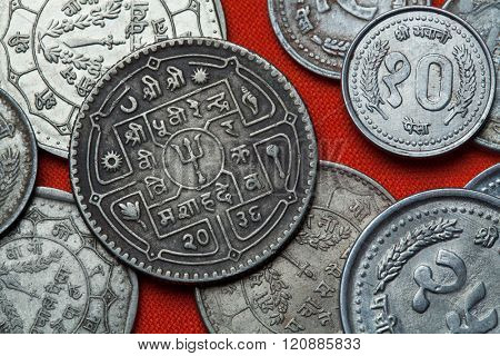 Coins of Nepal. Hindu trishul depicted in the Nepalese rupee coins.