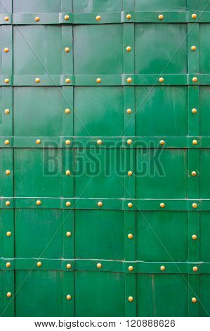 texture of green old metal door with rivets for background