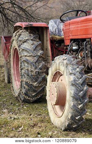 Old Tractor Closeup On Wheels