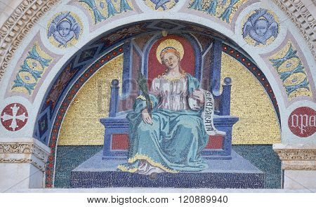 PISA, ITALY - JUNE 06, 2015: A colourful mosaic by Giuseppe Modena da Lucca, of the Saint Reparata, lunette above left door of Cathedral in Pisa, Italy. Unesco World Heritage Site, on June 06, 2015