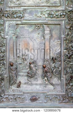 PISA, ITALY - JUNE 06: Adoration of the Magi, detail of the bronze door to the left of the Cathedral St. Mary of the Assumption in Pisa, Italy on June 06, 2015
