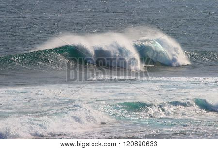 Indian Ocean wave breaking on rocks at Gris-Gris beach on Mauritius Island.