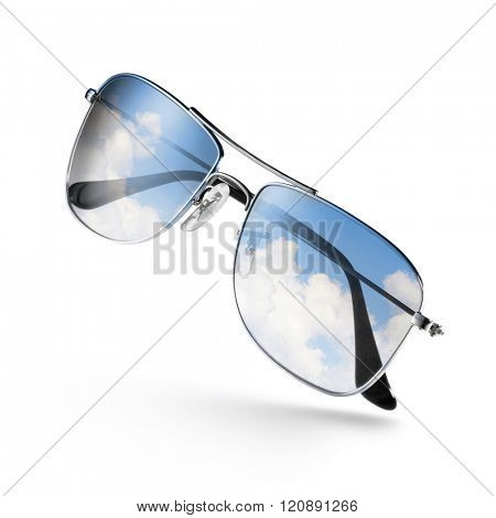 sunglasses with sky and clouds in reflection isolated on white