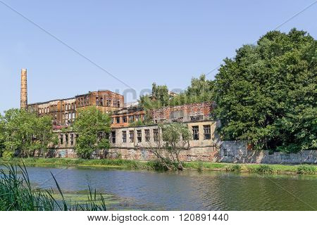 Factory ruins on river bank