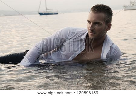 handsome man lying on the water