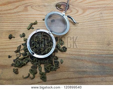 Dried Tea Leaves And Tea Strainer