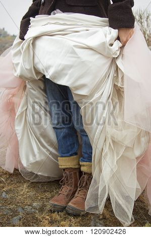 The woman wore jeans and simultaneously wedding dress