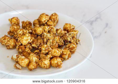 Caramel Popcorn On White Dish