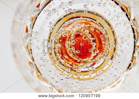 Wedding Golden Rings In Glass Of Champagne. Symbol Of Love And Marriage.