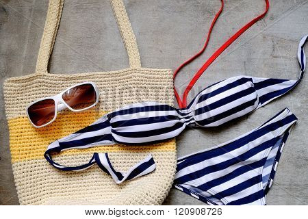 Striped Swimsuit And Sunglasses