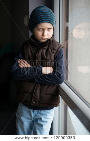Offended 7 Year Old Boy Standing By The Window