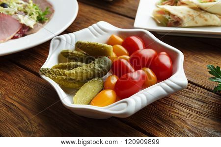 Restaurant food - pickled tomato and cucumber.