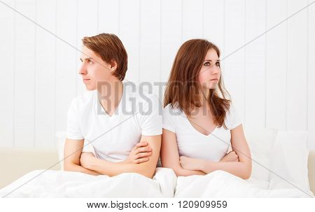 Upset Couple Having Marital Problems Or A Disagreement  In Bed
