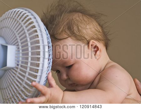 Baby With A Fan.