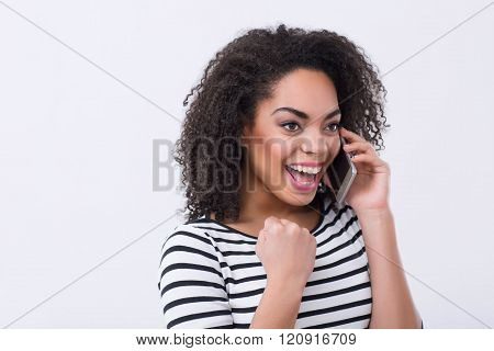 Cheerful mulatto woman smiling