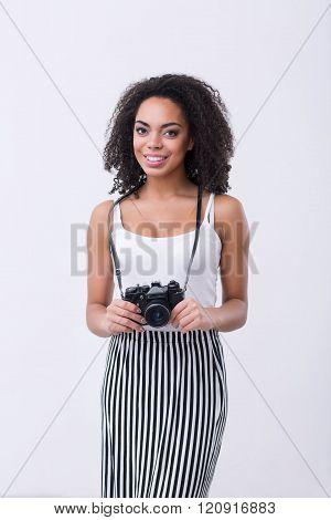 Smiling   woman holding photo camera