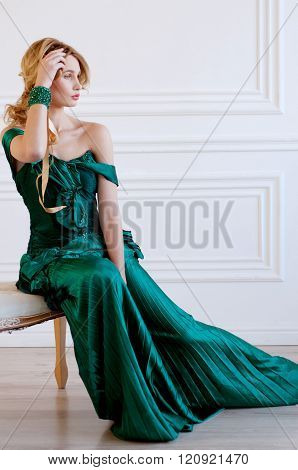 Shapely Blond Woman In Green Restoration Evening Gown And Bracelet