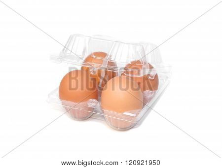 chicken eggs in a plastic tray on isolated background