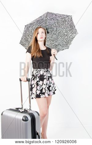 Young Woman With Suitcase And Umbrella On White Background