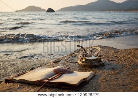 tropical rocky beach with old vintage sundial and note