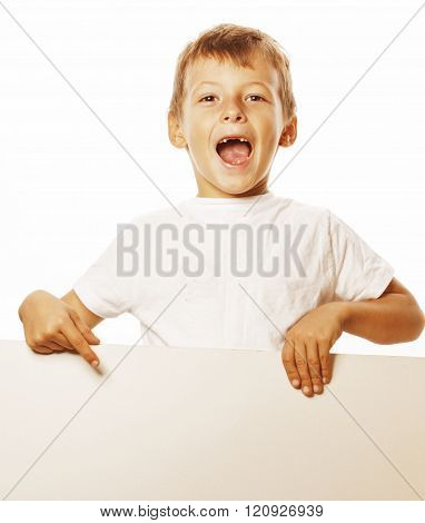 little cute boy holding empty shit to copyspace isolated close up gesturing smiling
