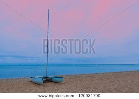 Catamaran On A  Sandy Beach