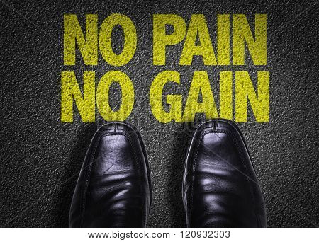 Top View of Business Shoes on the floor with the text: No Pain No Gain