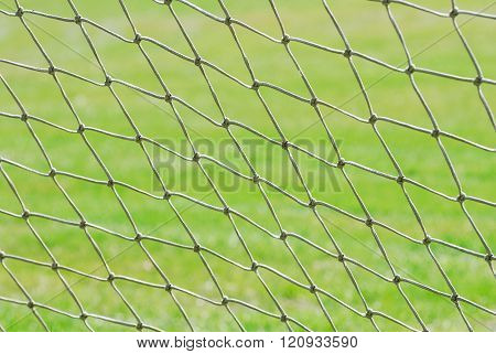 close up on football net against green grass