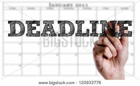 Hand writing the text: Deadline