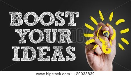 Hand writing the text: Boost Your Ideas