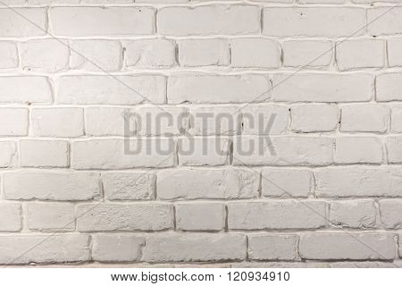 Weathered texture stained old white brick wall